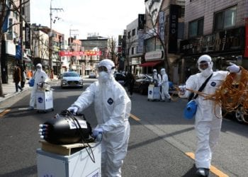 """SEOUL, SOUTH KOREA - FEBRUARY 27: Disinfection professionals wearing protective gear spray anti-septic solution against the coronavirus (COVID-19) on February 27, 2020 in Seoul, South Korea. Government has raised the coronavirus alert to the """"highest level"""" as confirmed case numbers keep rising. Government reported 334 new cases of the coronavirus (COVID-19) bringing the total number of infections in the nation to 1,595 with the potentially fatal illness spreading fast across the country. (Photo by Chung Sung-Jun/Getty Images)"""