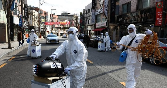"SEOUL, SOUTH KOREA - FEBRUARY 27: Disinfection professionals wearing protective gear spray anti-septic solution against the coronavirus (COVID-19) on February 27, 2020 in Seoul, South Korea. Government has raised the coronavirus alert to the ""highest level"" as confirmed case numbers keep rising. Government reported 334 new cases of the coronavirus (COVID-19) bringing the total number of infections in the nation to 1,595 with the potentially fatal illness spreading fast across the country. (Photo by Chung Sung-Jun/Getty Images)"