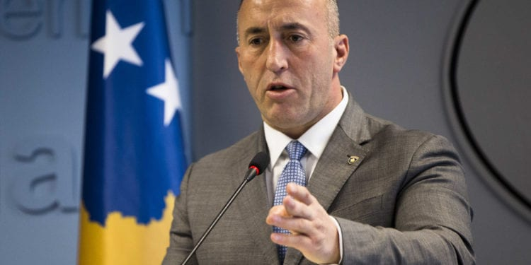 """Kosovo prime minister Ramush Haradinaj, speaks to the media during a press conference in Kosovo capital Pristina on Tuesday, Dec. 18, 2018. Haradinaj blamed Europe Union's foreign policy chief for """"deviating the dialogue"""" on normalizing ties with Serbia. Haradinaj said that, while Serbia is taking major steps toward the integration with the bloc, his country's residents have remained """"in a ghetto,"""" not enjoying the visa-free travel to EU countries though it has fulfilled all requirements. (AP Photo/Visar Kryeziu)"""