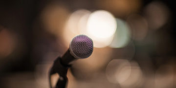 detail of a microphone with some bokeh on background