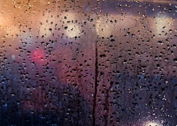 Abstract traffic in raining day. View from car seat. Rainy days, Rain drops on window, rainy weather, rain and bokeh