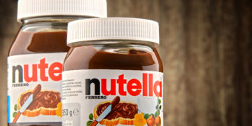 64636866 - poznan, poland - oct 11, 2016: introduced to the market in 1964 by italian company ferrero, nutella is widely popular brand name of a sweetened hazelnut cocoa spread
