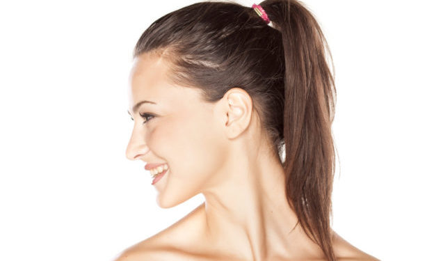 profile of a young smiling beautiful woman