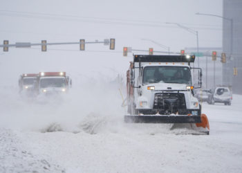 Snowplows works to clear the road during a winter storm Sunday, Feb. 14, 2021, in Oklahoma City. Snow and ice blanketed large swaths of the U.S. on Sunday, prompting canceled flights, making driving perilous and reaching into areas as far south as Texas' Gulf Coast, where snow and sleet were expected overnight. (AP Photo/Sue Ogrocki)