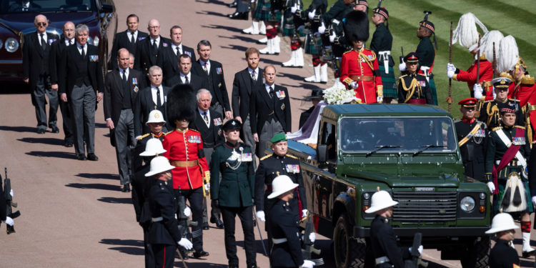 Family members follow the coffin during a procession arriving at St George's Chapel for the funeral of Britain's Prince Philip inside Windsor Castle in Windsor, England, Saturday, April 17, 2021. Prince Philip died April 9 at the age of 99 after 73 years of marriage to Britain's Queen Elizabeth II. (Eddie Mulholland/Pool via AP)