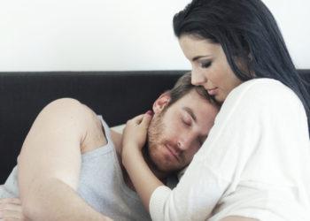 Woman comforts her husband.