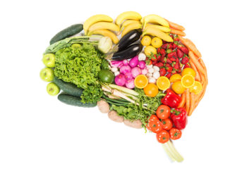 Brain made out of fruits and vegetables isolated on white background