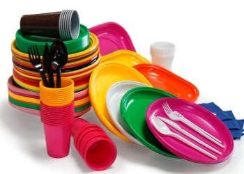 Bright Plastic tableware isolated on the white background